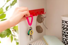Add a small set of hooks inside a fabric cubby to hang your keys, sunglasses + more.