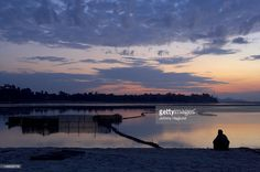 View top-quality stock photos of Sunrise Over The Brahmaputra River With Fisherman On The Shore Waiting For Fish To Enter His Nets. Find premium, high-resolution stock photography at Getty Images. Brahmaputra River, Continents, Sunrise, Waiting, Asia, Stock Photos, Mountains, Travel, Viajes