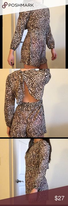 Leith leopard print romper Stand out in this sexy leopard print long sleeve romper. One piece in great condition, only worn once prior.    Zips at side and buttons behind the neck, open at the back   Size M Leith Pants Jumpsuits & Rompers