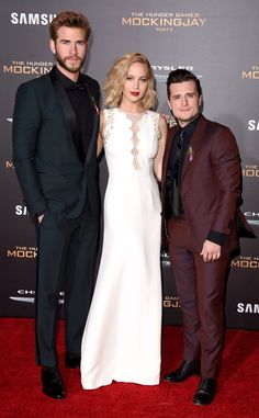 Liam Hemsworth, Jennifer Lawrence & Josh Hutcherson from The Hunger Games: Mockingjay Part 2 Premieres  The guys look dapper as ever in fitted suits while J.Law stuns in a white gown.