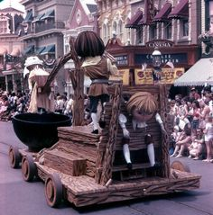 A Salem Witch Trial Float from the America on Parade at WDW. Only in Disney can witch trails looks so cute.