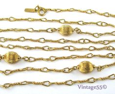 Monet Necklace 54 inch Gold tone 1970 Vintage by Vintage55 on Etsy, $28.00