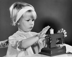 Vintage Sewing Machines and Quilting History: Child Sewing on a Toy Sewing Machine