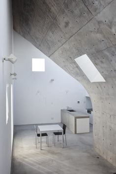 Dining Room And Kitchen At The Earth House By Nobuhiro Tsukada Architects