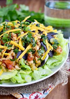 Picadillo-Style Chicken Taco Salad is a fresh and fast 30 minute meal. Switch up salad night tonight!