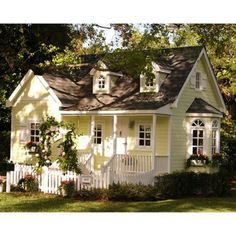 Little yellow cottage- Something I always wanted. A yellow cottage with a white picket fence.