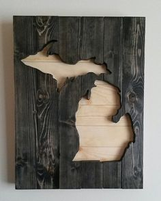 Wouldn't mind doing this or painting the state on old wood!