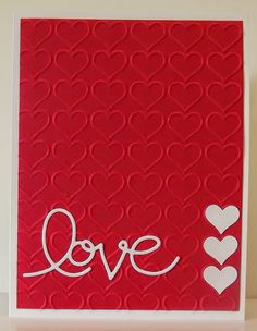 Stampin' Up! ... handmade Valentine card ... red and white ... hearts embossing folder texture ... three white hearts in a line ... die cut LOVE ...