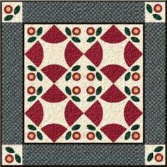 Flower Wheel   This block combines curved piecing and applique. However, if curves scare you, appliqué the entire block instead!
