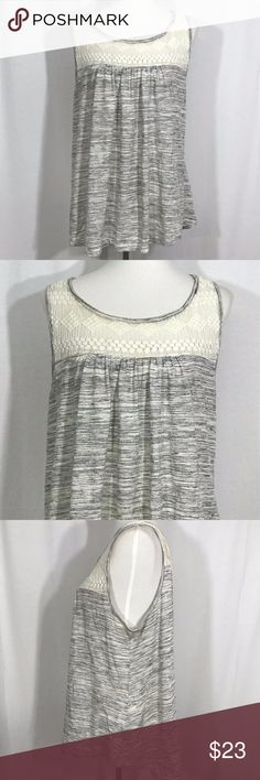 """Torrid Women Blouse Size 1 Gray Black Ivory Lace Torrid Women Blouse Size 1 Gray Black Ivory Lace Stretch Sleeveless Tank Top   Type: Blouse Style: Women Blouse Size 1 Gray Black Ivory Lace Stretch Sleeveless Tank Top Brand: Torrid  Size: 1 Color: Gray Black Ivory Measurements: (Laying flat) Shoulder to shoulder: 14"""", underarm to underarm: 23"""", Shoulder to hem: 27.5"""" Condition: Pre-owned, Used, No rips, No stains torrid Tops"""