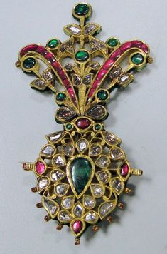 Antique 20K Royal Diamond Ruby Emerald Gold Maharaja turban pin pendant Jewelry: An antique turban pin from the house of Maharaja of Rajasthan, encrusted with old mine cut diamonds, rubies, emeralds set in 20 carat solid gold and back adorn with multicolor enamel. 9.5/5.5 cm, total weight-45.6 grams (1.60 ounces).