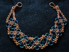 Annora by Narrina This is a Celtic Flower bracelet using copper, blue enameled copper, and peacock blue enameled copper.