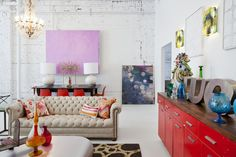 Eclectic Decor - A chesterfield sofa and red console at Buckingham Interiors + Design