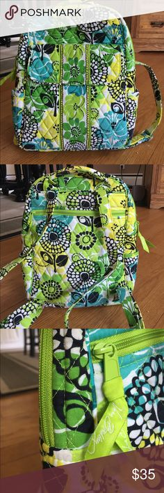 Like new Vera backpack!   Beautiful, spring colors backpack by Vera.  In perfect condition.  Adjustable straps, size pouches, outer magnetic close pocket. Vera Bradley Bags Backpacks