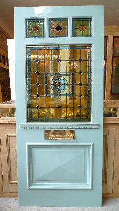 Edwardian Style Three Over One Panel Stained Glass Front Door Front Door Design idea: 3 over one above shelf and single panel Front Door Design, Front Door Colors, Front Door Decor, Edwardian House, Edwardian Fashion, Edwardian Style, Edwardian Hallway, 1930s Style, Victorian Houses