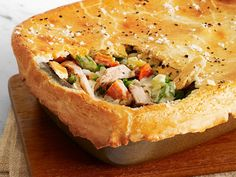 Lighter Chicken Pot Pie : Food Network Kitchen used just a little butter for a flaky yet lower-cal crust, then created a creamy sauce with low-fat milk and Greek yogurt.
