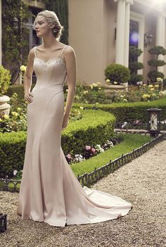 Casablanca Bridal - Primrose. Primrose is a modern fit-n-flare gown with sleek lines complimented by the ornately beaded back. The beaded sweetheart neckline adds a touch of sparkle to the front of this jaw dropping gown.