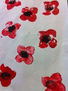 Anzac Day Poppy Craft - simple potato print poppies with real poppy seed centres.