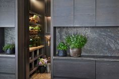A Liaigre-Designed Masterpiece in Munich - Architectural Digest In the back kitchen and pantry are made-to-measure storage units in dark brushed oak and cedar. Cedar Paneling, Cedar Walls, Black Dagger Brotherhood, Christian Liaigre, Paper Lampshade, Stone Facade, Architectural Digest, Munich, White Walls