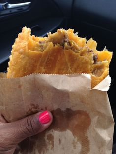 Yes ma'am - the Jamaican patty.  Comes in a few varieties - spiced meat, chicken, lamb, vegetarian - wrapped in a flaky yellow pastry.  A West Indian staple available in many Caribbean islands and around the world.
