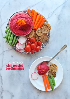 Chili Roasted Beet Hummus --- such an amazing flavor and color... and perfect for parties!! // via Nosh and Nourish