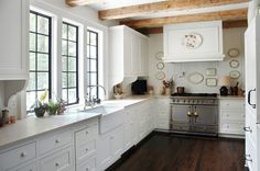 Add Character with Beams - Design Chic windows above sink. painted black. simple shaker style drawer fronts.