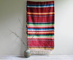 hang serape in front entrance...a bright pink/turquoise color one tho