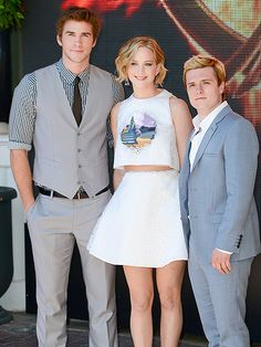 CANNES DO! Call it The Hunger Games: Cannes. Liam Hemsworth, Jennifer Lawrence and Josh Hutcherson pose at the photo call for The Hunger Games: Mockingjay Part 1 at the Cannes Film Festival Saturday.