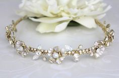 Beautiful gold bridal headband created with lovely flowers and hand wire wrapped and finished with clear and white opal Austrian crystals.  Headband measures 13 inches x 7/8  Ends with loops so you can secure with bobby pins.  Back to my shop: