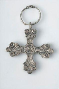 Viking era silver pendant, cross shaped. Found at Gotland, Sweden. The Swedish History Museum, Stockholm.