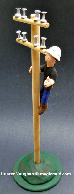 Electricians gift figurine  www.magicmud.com 1 800 231 9814 creating a custom made gift figurine for any man based on the things he likes to do! ...incorporating his work, sports, family, hobbies, food, drink, electronic gadgets, etc. $225 #dad #men #guys #christmas #birthday #electrician #anniversary #custom #personalized #xmas #present #award #ChristmasGift #BirthdayGift #husband