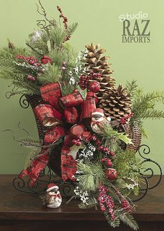 Sleigh arrangement. Christmas centerpiece and decorating ideas.