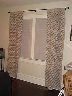 Stenciled Drop Cloth curtains. This seems like it would take forever, but I love the look of it.