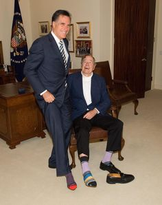 Gotta Luv it! George H. W. Bush showing off  his fashion socks. Mitt Romney Joins in for fun.