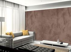 Na sala de estar, destaque para a parede lateral com acabamento em efeito camurça (cor Chocolate ao Leite - Tintas Suvinil)
