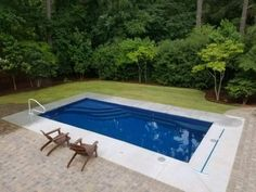 Parrot Bay Pools Rectangle Fiberglass Pool In Pool Tanning shelf #parrotbaypools #Fuquay Varina