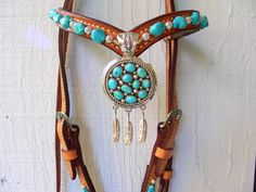 Vintage Navajo pendant with feathers and matching turquoise stones.