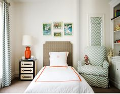 love that trunk for a nightstand and orange lamp. and chevron.  what a great kids room that is filled with pieces that can grow with the child.