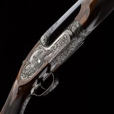 A Westley Richards .416 Sidelock double rifle with single trigger and relief game scene engraving.
