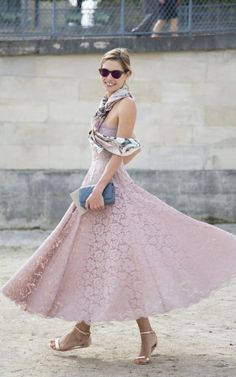 Model Jessica Hart showing that lace doesn't need to be the reserve of occasion wear. Try looping a silk scarf around your neck for a jaunty flourish