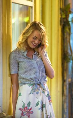 Emma Stone blue tied blouse and white flowered skirt