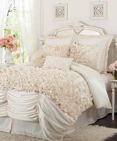 Now I like a good ruffle or frilly accent, but this bedding ensemble makes me want to barf.  I envision a pampered princess type lounging in this bed all day acting like a B.  Stupid thing.