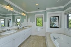 Spa-Like Relaxing Master Bathrooms | The spa-like master bathroom has a separate bathtub and shower as well ...
