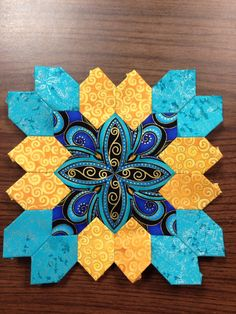 """Lucy Boston (POTC/Patchwork of the Crosses) block made with English Paper Piecing. By Tracy Pierceall 2015.  Middle fabric is Timeless Treasures """"Plume."""""""