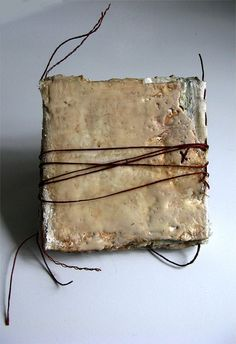 Love Notes to Winter is a mixed media and encaustic artist book. The artist is Bridgette Guerzon Mills.