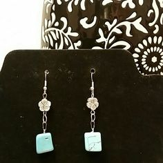 Turquoise & Silver flower drop earrings Semi-precious Turquoise & Silver toned flower drop earrings. These are an alloy metal, they are not stamped .925 sterling silver. They have Fish hook (or Shepard's hook) posts. Turquoise squares are approximately 12mm x 12mm Jewelry Earrings