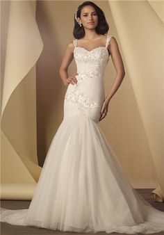 Alfred Angelo Soft net overlay sweetheart fit and flare gown featuring dramatic metallic embroidery and crystal beading. Low open back and chapel train
