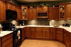 Kitchen colors with brown cabinets kitchen color ideas kitchen color ideas with oak cabinets kitchen paint Kitchen Cabinets With Black Appliances, Dark Oak Cabinets, Kitchen Cabinets Materials, Honey Oak Cabinets, Painting Oak Cabinets, Unfinished Cabinets, White Cabinets, Large Cabinets, Kitchen Walls