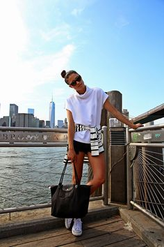 Shop this look on Lookastic:  http://lookastic.com/women/looks/sunglasses-and-turtleneck-and-crew-neck-sweater-and-shorts-and-tote-bag-and-low-top-sneakers/3448  — Dark Brown Leopard Sunglasses  — White Turtleneck  — White and Black Horizontal Striped Crew-neck Sweater  — Black Ripped Denim Shorts  — Black Canvas Tote Bag  — White Low Top Sneakers