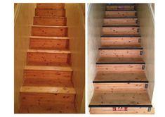 """Mise au style industriel d'un simple escalier en pin grâce à des cornières en fonte noire comme nez de marche, des  pochoirs chiffres en métal et 2 plaques émaillées """"haut et bas"""" comme sur les caisses de transport."""
